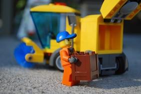 Sidewalk sweeper rear compartment