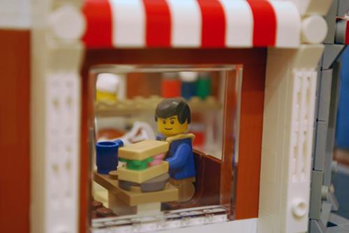 The booth as seen through my LEGO Corner Deli Window.