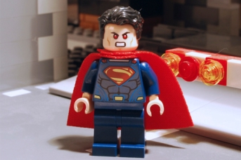 LEGO Superman with angry laser eyes.