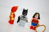 Side view of Firestorm, and alternate faces for Batman and Wonder Woman.