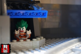 A grate can be lifted in the train tunnel to reveal the bottom of the slide where Minifigures exit the sewer.