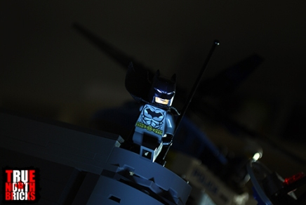 Batman responds to the call from Commissioner Gordon.