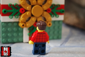 Rear view of the adult Minifigure included with the Buildable Holiday Present.